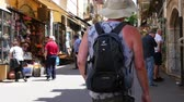 sicílie : TAORMINA, ITALY - CIRCA JUNE 2018:  View on daily life as pedestrians pass by on the historic streets of the city centre on a sunny day circa June 2018 in Taormina, Italy. Dostupné videozáznamy
