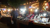 pattaya : PATTAYA, THAILAND - CIRCA FEBRUARY 2018: View on locals and tourists as they pass by at street vendors in the night market in center of the city circa February 2018 in Pattaya, Thailand. Stock Footage