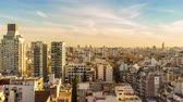 федеральный : Time-lapse view of high rise buildings in light of the evening sun in Buenos Aires.