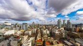 cabaça : Time-lapse view on the skyline of the city from a balcony of a high rise apartment as Sun breaks through between fast move clouds in Buenos Aires.