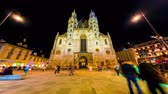 viyana : VIENNA, AUSTRIA - CIRCA APRIL 2018: Time-lapse view on pedestrians as they pass by on the square front of the gothic building of the St. Stephens Cathedral in the evening circa April 2018 in Vienna, Austria. Stok Video