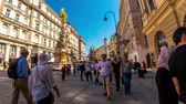 austrian : VIENNA, AUSTRIA - CIRCA APRIL 2018: Time-lapse view of pedestrians as they pass by on the walking street in the historic centre of the city on a sunny day circa April 2018 in Vienna, Austria