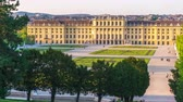 imperial : VIENNA, AUSTRIA - CIRCA APRIL 2018: Time-lapse view on the baroque architecture of the Schoenbrunn Palace as tourist pass by on the walkway circa April 2018 in Vienna, Austria. Stock Footage