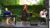 zongora : NAGYHARSANY, HUNGARY - CIRCA AUGUST 2018: The talented Croatian artist Jelena Radan performs fado songs live on the stage of Ordogkatlan Festival circa August 2018 Nagyharsany, Hungary Stock mozgókép
