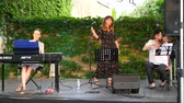 hırvat : NAGYHARSANY, HUNGARY - CIRCA AUGUST 2018: The talented Croatian artist Jelena Radan performs fado songs live on the stage of Ordogkatlan Festival circa August 2018 Nagyharsany, Hungary Stok Video