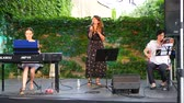 croata : NAGYHARSANY, HUNGARY - CIRCA AUGUST 2018: The talented Croatian artist Jelena Radan performs fado songs live on the stage of Ordogkatlan Festival circa August 2018 Nagyharsany, Hungary Stock Footage