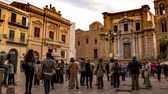 main street : PALERMO, ITALY - CIRCA JUNE 2018: Time-lapse view on the historic architecture of the main square as people pass the iconic buildings of the old town during the day circa June 2018 in Palermo, Italy. Stock Footage