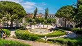 chiostro : CATANIA, ITALY - CIRCA JUNE 2018: Time-lapse view on people as they pass by at the historic Bellini Garden park on a sunny day circa June 2018 in Catania, Italy.