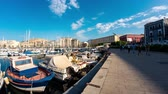 palerme : PALERMO, ITALY - CIRCA JUNE 2018:  Time-lapse on Boats and yachts as they park in La Cala bay, the old port in the historic centre of the city circa June 2018 in Palermo, Italy. Vidéos Libres De Droits