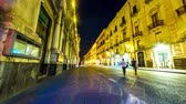 sicílie : CATANIA, ITALY - CIRCA JUNE 2018: Time-lapse view on historic architecture of the downtown as people pass by on the cobblestones streets at night circa June 2018 in Catania, Italy. Dostupné videozáznamy