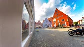 godo : NOERDLINGEN, GERMANY - CIRCA SEPTEMBER 2018: Time-lapse view on the historic architecture as pedestrians pass by on the city centre on a sunny day circa September 2018 in Noerdlingen, Germany Vídeos