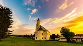 Time-lapse view of a Church on the edge of Wemding, Germany as sunlit clouds sail slowly across the sky.