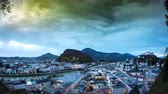 Spectacular panorama time-lapse view on the historic architecture of the city centre with dramatic clouds on the sky during sunset in Salzburg, Austria.