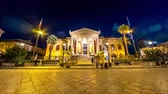 sicílie : PALERMO, ITALY - CIRCA JUNE 2018: Time-lapse view on the historic building of The Massimo Theater, the Opera House as people pass by front of the building in the centre of the city at night circa June 2018 in Palermo, Italy.