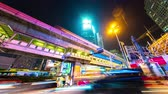 skywalk : BANGKOK, THAILAND - CIRCA MARCH 2018: Time-lapse view on illuminated streets of the city as traffic passes by at night circa March 2018 in Bangkok, Thailand. Stock Footage