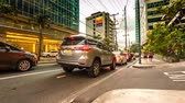 estacionamento : METRO MANILA, PHILIPPINES - CIRCA MARCH 2018: Time-lapse view of traffic on the streets of the city as cars and pedestrians pass by during dusk circa March 2018 in Metro Manila, Philippines.