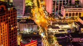 построен структуры : METRO MANILA, PHILIPPINES - CIRCA MARCH 2018: Time-lapse view on the traffic of a busy crossroad in Makati at night circa March 2018 in Metro Manila, Philippines. Стоковые видеозаписи