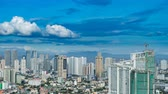 подниматься : METRO MANILA, PHILIPPINES - CIRCA MARCH 2018: Time-lapse view on the skyline of Makati as clouds pass through the blue sky circa March, 2018 in Metro Manila, Philippines. Стоковые видеозаписи