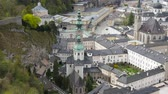 riverbank : Panorama view on the historic architecture of the city centre in Salzburg, Austria. Stock Footage