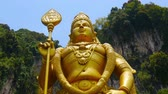 enlightenment : Giant Murugan Statue in front of the Batu Caves close to Kuala Lumpur in Malaysia. Stock Footage