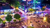 夜遊び : HO CHI MINH CITY, VIETNAM - CIRCA FEBRUARY 2018: Time-lapse view as pedestrians and cars pass by on the street and the main square in the downtown at night circa February 2018 in Ho Chi Minh City, Vie