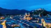 riverbank : Spectacular panorama time-lapse view on the historic architecture of the city centre during sunset in Salzburg, Austria.