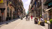 palerme : PALERMO, ITALY - CIRCA JUNE 2018: Time-lapse view on pedestrians as they walk by the famous walking street in the city centre on a sunny day circa June 2018 in Palermo, Italy. Vidéos Libres De Droits