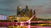 arjantin : BUENOS AIRES, ARGENTINA - CIRCA FEBRUARY 2019: Time-lapse view on skyscrapers and the famous Bridge of the Woman in the neighborhood of Puerto Madero circa February 2019 in Buenos Aires, Argentina.
