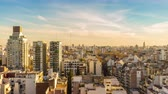 Time-lapse view of high rise buildings in light of the evening sun in Buenos Aires.
