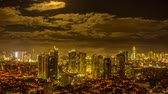 akşam vakti : Time-lapse view on the illuminated skyline of Makati during sunset.