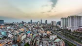 인도 차이나 : HO CHI MINH CITY, VIETNAM - CIRCA MARCH 2018: Time-lapse view on the skyline of the city at the riverside during sunset circa March 2018 in Ho Chi Minh City, Vietnam.