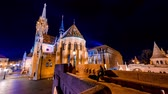wegry : BUDAPEST, HUNGARY - CIRCA APRIL 2019: Time-lapse view on visitors in the illuminated Fishermans Bastion in the evening circa April 2019 in Budapest, Hungary.