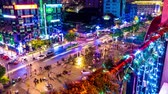夜遊び : HO CHI MINH CITY, VIETNAM - CIRCA FEBRUARY 2018: Time-lapse view as pedestrians and cars pass by at night circa February 2018 in Ho Chi Minh City, Vietnam. 動画素材