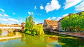 NUREMBERG, GERMANY - CIRCA MAY 2019: Time-lapse view on historic Architecture and the River Pegnitz in the centre of the city circa May 2019 in Nuremberg, Germany.