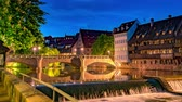 bayrisch : NUREMBERG, GERMANY - CIRCA MAY 2019: Time-lapse view the River Pegnitz and historic Architecture at night circa May 2019 in Nuremberg, Germany.