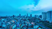 vietnamita : HO CHI MINH CITY, VIETNAM - CIRCA MARCH 2018: Time-lapse view on the skyline of the city at the riverside during sunset circa March 2018 in Ho Chi Minh City, Vietnam.