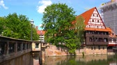 bayrisch : NUREMBERG, GERMANY - CIRCA MAY 2019: View historic Architecture and the river Pegnitz as it flows through the city circa May 2019 in Nuremberg, Germany.