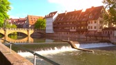 tedesco : NUREMBERG, GERMANY - CIRCA MAY 2019: View historic Architecture and the river Pegnitz during sunset circa May 2019 in Nuremberg, Germany.