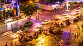HO CHI MINH CITY, VIETNAM - CIRCA FEBRUARY 2018: Time-lapse view as pedestrians and cars pass by at night circa February 2018 in Ho Chi Minh City, Vietnam. Stok Video