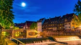 NUREMBERG, GERMANY - CIRCA MAY 2019: Time-lapse view the River Pegnitz and historic Architecture at night circa May 2019 in Nuremberg, Germany.