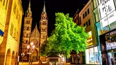 NUREMBERG, GERMANY - CIRCA MAY 2019: Time-lapse view the centre of the city and the famous church St. Lawrence at night circa May 2019 in Nuremberg, Germany. Stok Video