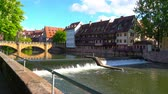 NUREMBERG, GERMANY - CIRCA MAY 2019: View historic Architecture and the river Pegnitz as it flows through the city circa May 2019 in Nuremberg, Germany.