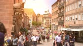vastgoed : NUREMBERG, GERMANY - CIRCA MAY 2019: View on People and Tourists as they visit the famous historic old town during sunset circa May 2019 in Nuremberg, Germany.