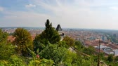 GRAZ, AUSTRIA - CIRCA AUGUST 2019: View over the famous Uhrturm on the Schlossberg and the city circa August 2019 in Graz, Austria.