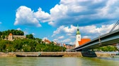Словакия : BRATISLAVA, SLOVAKIA - CIRCA AUGUST 2019: Time-lapse view over the city, the castle and the river Danube circa August 2019 in Bratislava, Slovakia.