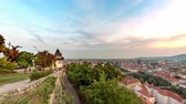 GRAZ, AUSTRIA - CIRCA AUGUST 2019: Time-lapse view of the sunset over the famous Uhrturm on the Schlossberg and the city circa August 2019 in Graz, Austria.