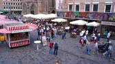немецкий : NUREMBERG, GERMANY - CIRCA MAY 2019: View on people as they visit the local market on a central square circa May 2019 in Nuremberg, Germany. Стоковые видеозаписи