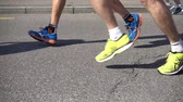 runners : slow movement of running marathon runners