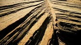 provocação : Striations in rock formations caused by natural wind & water erosion in close-up