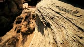 provocação : The scarred surfaces of rock in a desert environment caused by erosion through wind & rain  Stock Footage